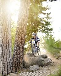 Kelli Emmett blasts down the Funner trail on her way to winning the women's race.