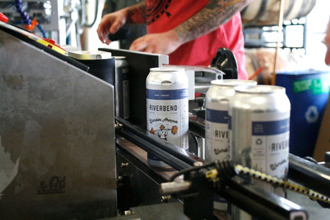 Cans of Riverbend's Blunder Armour roll off the canning line in the war against clothing giant Under Armour. - ISAACBIEHL