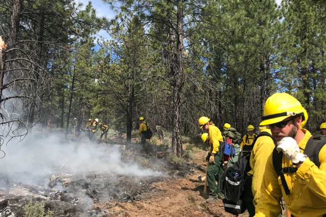 Firefighters work on a prescribed burn near Sisters, Ore. in June 2018. - PROJECT WILDFIRE