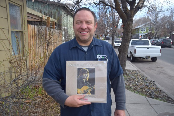 """Cole Smith shows off his """"A History Of Eric Clapton"""" album. - ISAAC BIEHL"""