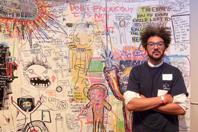 Mosely Wotta (Jason Graham) in front of his piece titled W.O.E. 1. - SUBMITTED