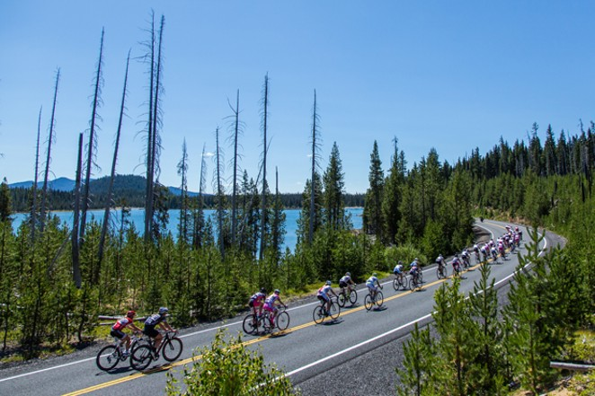 Racers roll along the road during one of the stages of a past Cascade Cycling Classic. - WHIT BAZEMORE