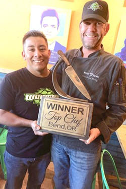 Chef Juan Infante and Sous Chef Shawn McCoy are all smiles, holding the Top Chef trophy at 