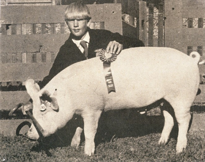 An FFA member proudly shows his pig during a past fair in this undated photo. - COURTESY DESCHUTES COUNTY FAIR & EXPO CENTER