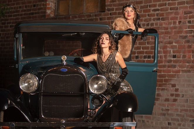 Cheers to Gallery Garage for the use of their 1928 Model A for this year's Roaring '20s-themed cover shoot! - MEGAN BAKER