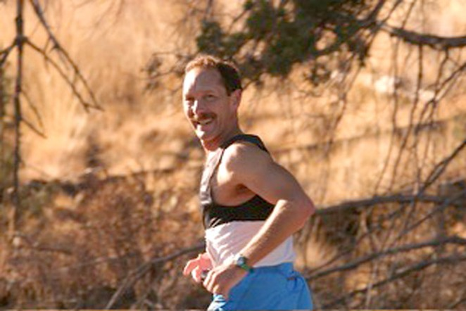 """The author running the Oct. 10, 2004 """"Just Around the Bend Marathon,"""" where he finished 28th overall, and 1st in the 50-54 age group. - BOB WOODWARD"""