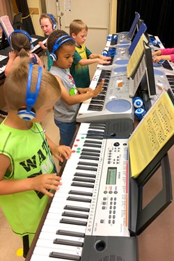 Students at Ponderosa Elementary School dive into music after receiving a grant for more keyboards. - COURTESY EDUCATION FOUNDATION