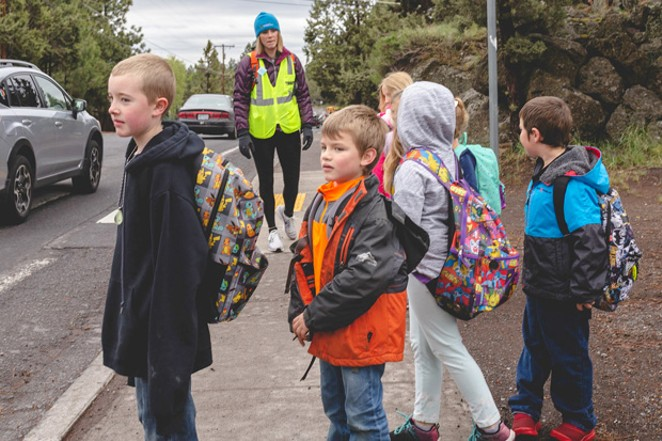 Students join a walking school bus to Juniper Elementary. - TAMBI LANE PHOTOGRAPHY