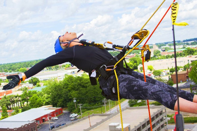 """The Over the Edge event sends local people rappelling off the Oxford Hotel building Saturday. Here, a participant goes """"over the edge"""" at another location. - COURTESY UNITED WAY OF DESCHUTES COUNTY"""