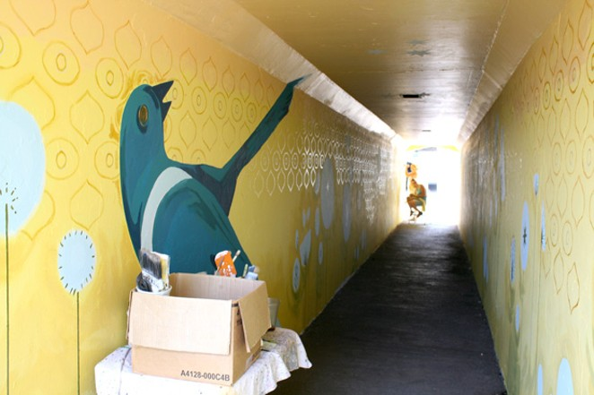 "FILE PHOTO—Kaycee Anseth and Shelly Hopson work on the mural, ""Two For Joy,"" in the northern tunnel of the Franklin Avenue underpass, inside the Bend Central District. - NICOLE VULCAN"