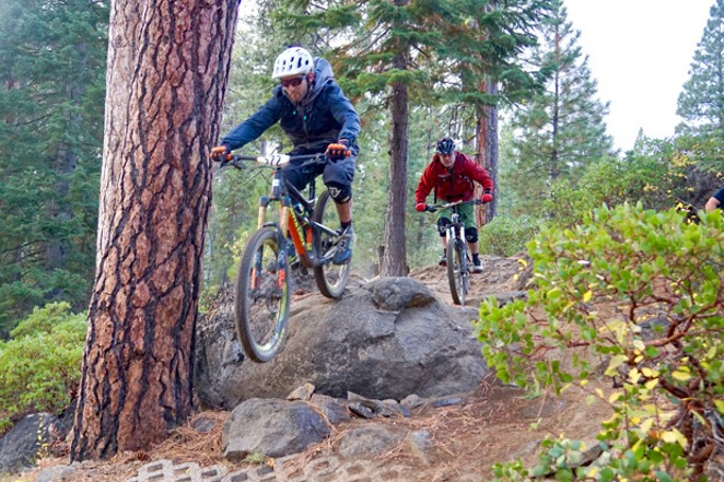 Riders traverse a technical section of trail during a previous Oregon Cancer Bike Out. - SUBMITTED