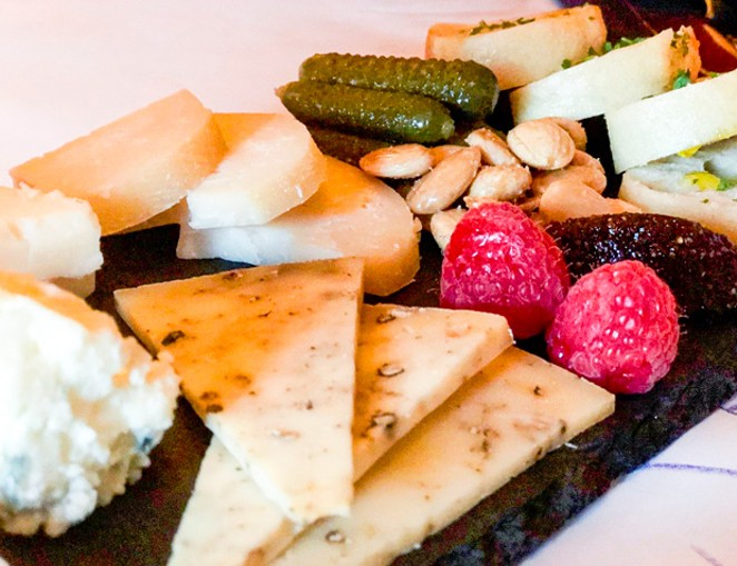 Fromagerie from the Red Martini, featuring five rich, creamy cheeses. - KEVIN BRYAN