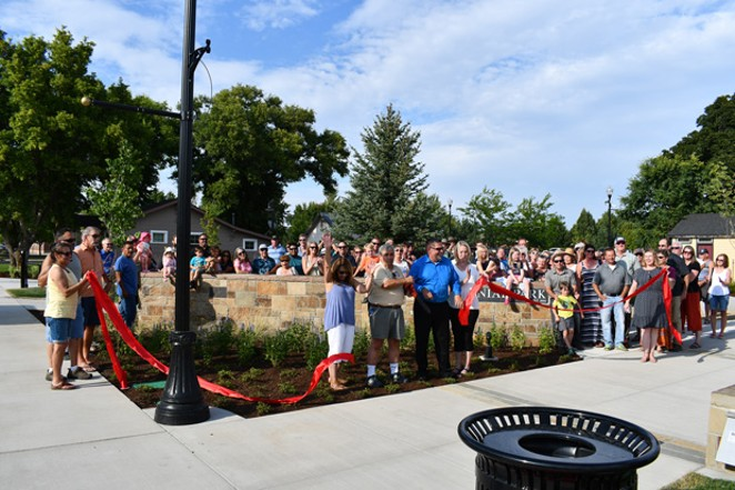 Locals observe the ribbon cutting at the official opening of the Centennial Park extension, August 2019. - CITY OF REDMOND