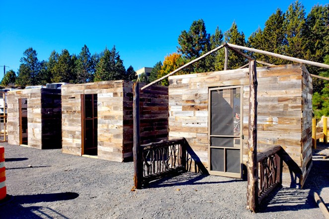 Three recyclable cabins being constructed for the Deschutes Warehouse Party. - CAYLA CLARK