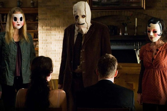 "In ""The Strangers,"" vinyl spins a spooky mix of tension and despair. - COURTESY ROGUE PICTURES"