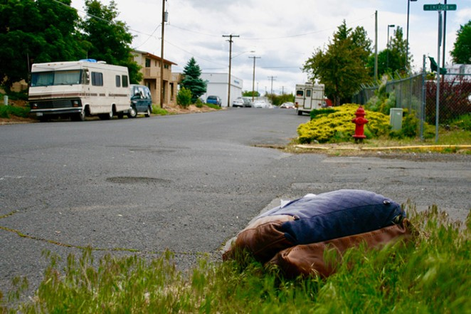 In June 2019, soon after new parking limits went into place, Source Reporter Chris Miller sought reaction from local people who live in their vehicles. This is a file photo from NE Emerson Ave. and 2nd St., where Miller talked with numerous people who often park on city streets overnight. Most said they were worried about how the changes would affect their abilty to park and sleep in peace. - CHRIS MILLER