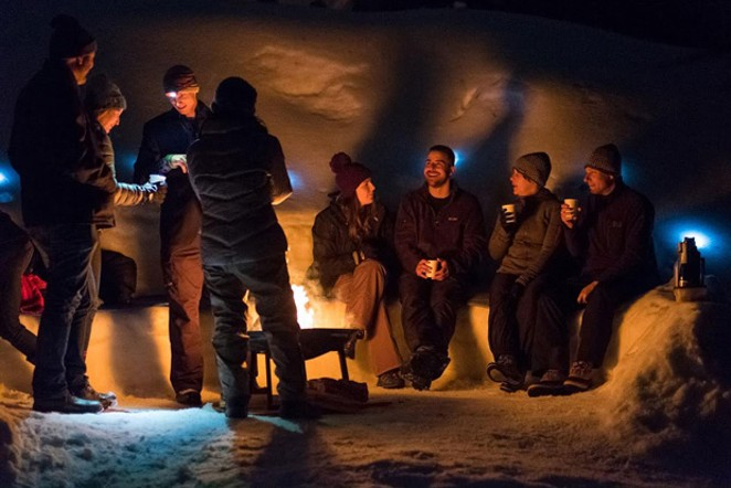 Once they reach the bonfire, tour-goers enjoy spiked hot cocoa, treats and conversation. - BRAD BAILEY