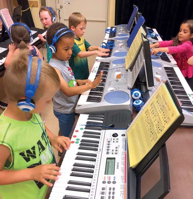 Students at Ponderosa Elementary learn the ropes of the keyboard thanks to a grant from the Education Foundation. - SUBMITTED