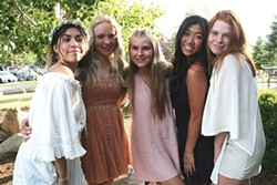 """Sophia Rodriguez and some of her """"damas"""" share a light moment outside her quinceañera party. - NICOLE VULCAN"""
