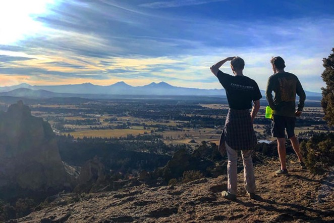 It's all about the views! Source staffer Isaac Biehl shows a Minnesotan visitor around Smith Rock. - LACEY ROOT