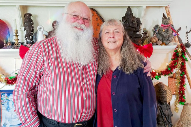 Mani and his wife Kim (also known as Mrs. Claus) in their home in Bend. - CAYLA CLARK