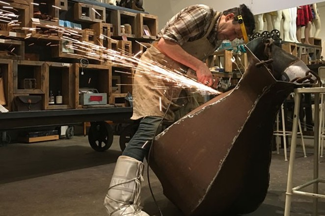 Stuart Breidenstein of Bright Place Gallery, seen here creating a fire pit for Oregon WinterFest, announced the closure of his artists' space this fall. - ABBY DUBIEF