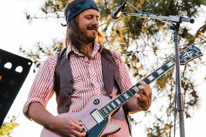 Eric Leadbetter is a class-rock singer/songwriter who played 260 live shows last year. He says he's one of a few local musicians who make a living through music alone. - ERICA SWANTEK