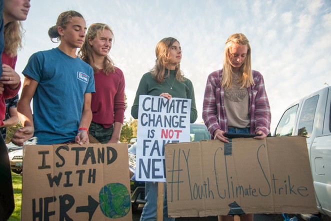Kira Gilbert—pictured center right, in a green sweater—is the co-president of the Bend Senior High School Environmental Club. - AARON DUARTE