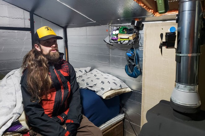 Thirteen blankets and a wood-burning stove help keep Mark Thompson warm when his cabin is covered in snow. - CAYLA CLARK