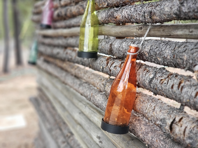 Bottles hanging on a wall! Wow! Artsy! I've been having fun exploring the woods and seeing what strange, photogenic things I fine. - CAYLA CLARK