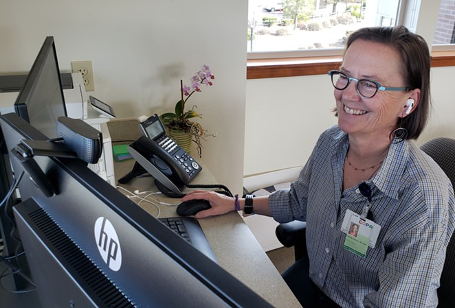 Dr. Carolyn Guttman, pediatrician at COPA, at her Zoom station. - COURTESY COPA
