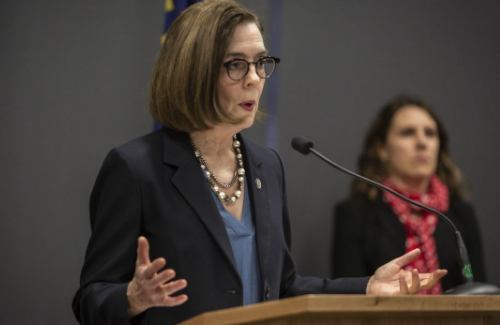 Gov. Brown, seen here during a news conference Friday, issued a more restrictive order this morning. - GOV. KATE BROWN