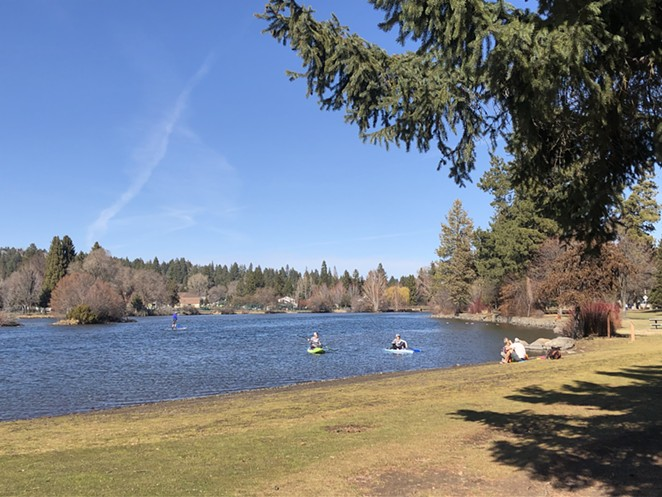 Mirror Pond in Bend's Drake Park Sunday. Bend Park and Recreation District is keeping parks open and requiring 6 feet of social distancing, but closing skate parks, exercise equipment, skate parks and courts. - NICOLE VULCAN