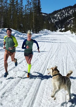 Chris Patterson and Renee Metivier enjoy a snowy run with Raider the Husky. - COURTESY RENEE METIVIER