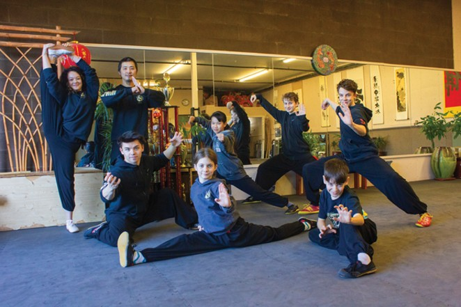 Master JianFeng Chen and Oregon Tai Chi Wushu students prepare for an upcoming IWUF competition. - DARRIS HURST