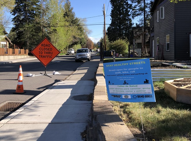 """Bend Bikes partnered with the City of Bend to install bilingual informational signs on streets designated as """"Stay Healthy Streets,"""" including NE 6th and NW 15th, which are also the City's first Neighborhood Greenways. - NICOLE VULCAN"""