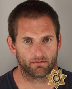 Troy Kenneth Dahl was accused of assaulting his disabled friend by removing his prosthetic and threatening to set him on fire. - DESCHUTES COUNTY JAIL