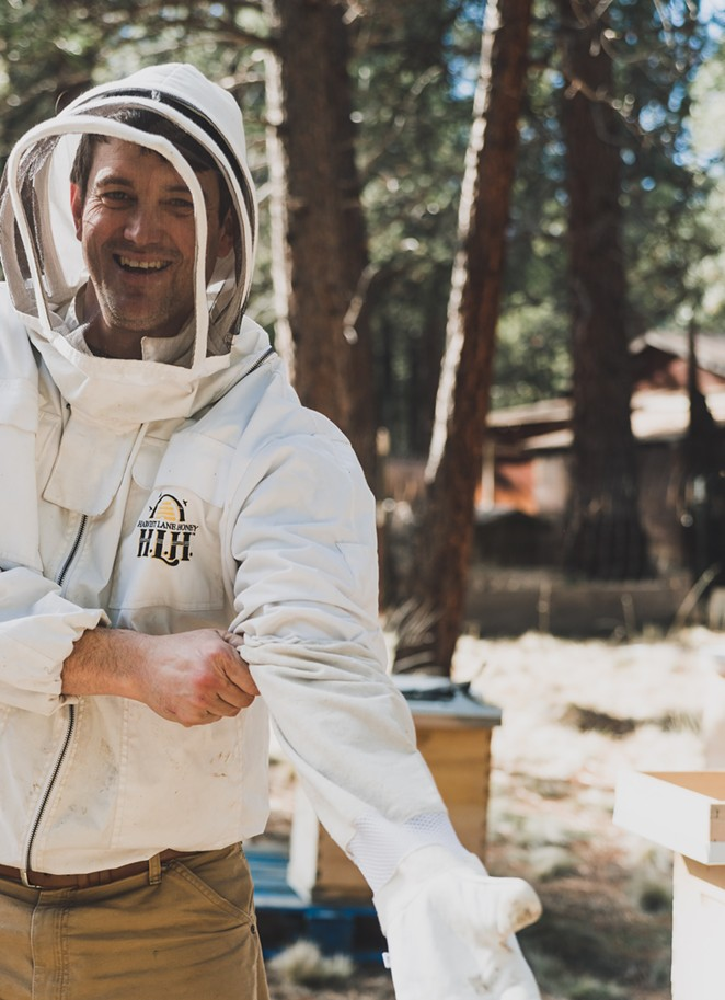 Bend beekeeper Jimmy Wilkie suits up to protect himself while tending to his hives. - AMANDA LONG