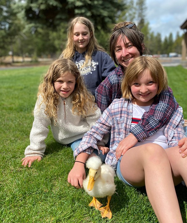 Sara Walker poses with her three, er... four children (including Miss Quackers) in Sunriver. - DYLAN WALKER