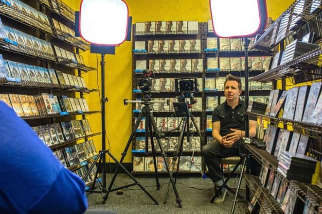 Filming inside The Last Blockbuster. - PHOTO BY GARY EIDSMOE