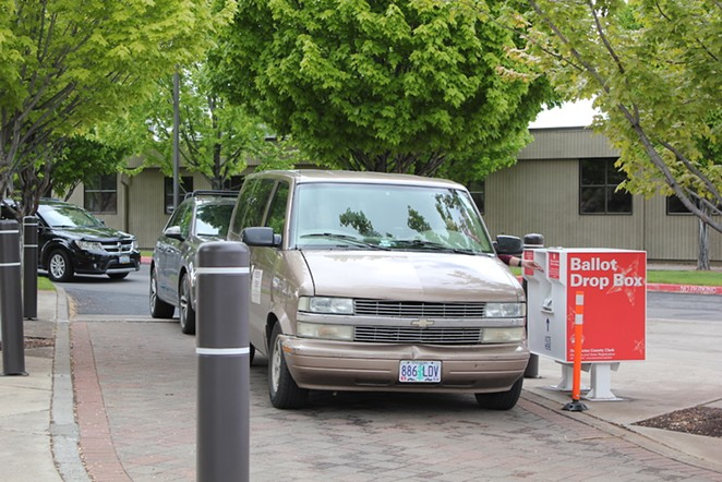 Last minute ballot drop-offs at the Deschutes County Services Building at 6pm Tuesday night. - LAUREL BRAUNS