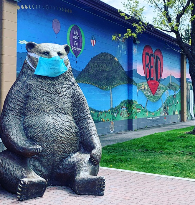 The big bear outside of Newport Avenue Market encourages mask-wearing. - MICHELLE TAGER MCCARTHY
