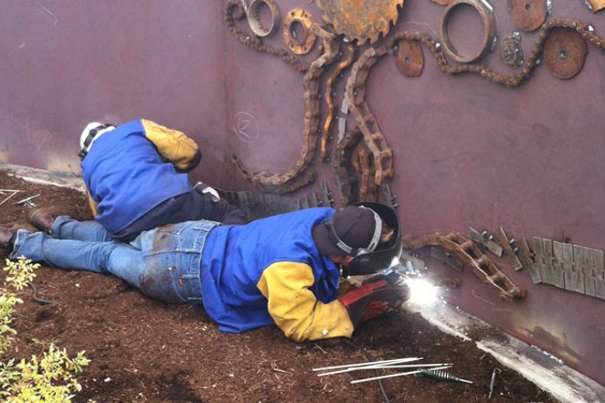 Redmond High School students weld the Constant Face of Temporary Existence. - CITY OF REDMOND