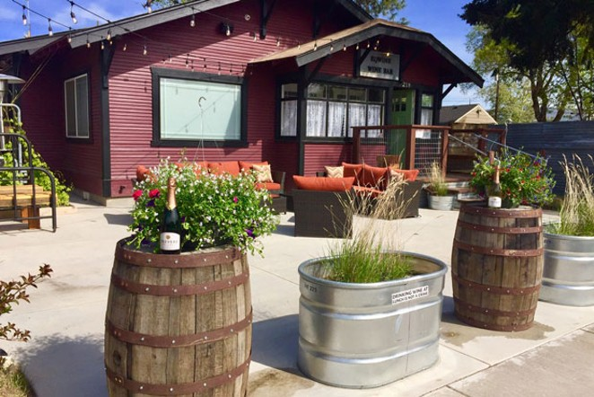 The patio at the new Eqwine Wine Bar looks inviting. - EQWINE WINE BAR