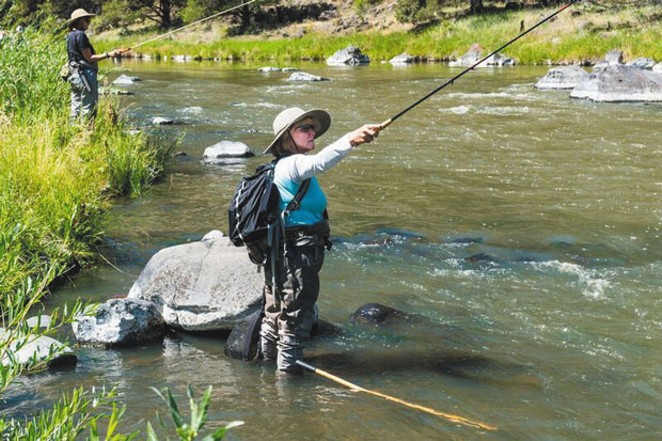 A member of Wild Women of the Water flex their fly fishing skills while enjoying the beautiful Central Oregon landscape. - COURTESY WILD WOMEN OF THE WATER