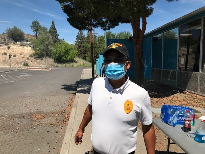 Danny Martinez works as the emergency manager for the Confederated Tribes of Warm Springs. On July 28, he's working one the many water stations he set up throughout the community to provide clean drinking water to the people on the reservation. - DANNY MARTINEZ