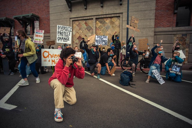 Maxwell Friedman snaps photos during a June 6 march on Bend CIty Hall that continued around downtown Bend - SOREN NYQUIST