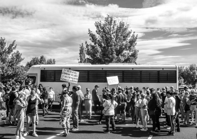 Hundreds gather to prevent U.S. Immigration and Customs Enforcement officers to leave with two Bend residents inside. The buses were parked in the Crane Shed Commons August 12, 2020. - KYLE SWITZER