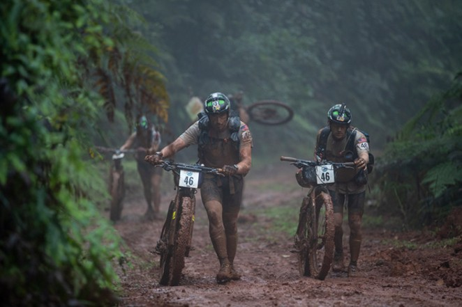 Team Bend tackles a mountain biking portion of the Eco-Challenge, and the road at this point in the competition was physically unrideable. - COURTESY AMAZON STUDIOS