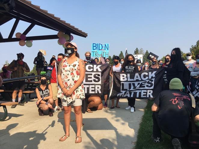 Kerstin Arias makes a speech to other activists at Pilot Butte on Oct. 3. - KERSTIN ARIAS